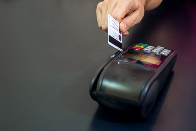 Female hand with credit card and bank terminal, Card machine or